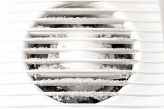 Extremely dirty and dusty white plastic ventilation air grille at home close up, harmful for health stock photography