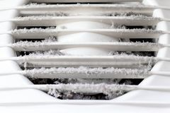 Extremely dirty and dusty white plastic ventilation air grille at home close up, harmful for health stock images