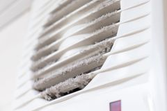 Extremely dirty and dusty white plastic ventilation air grille at home close up, harmful for health royalty free stock photos