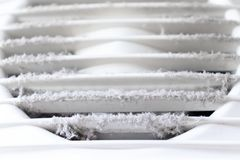 Extremely dirty and dusty white plastic ventilation air grille at home close up, harmful for health stock photo