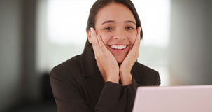 Extremely excited latina woman intern gets offered a job Stock Photos