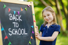 Extremely excited little schoolgirl. Adorable little schoolgirl feeling extremely excited about going back to school Stock Image