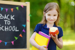 Extremely excited little schoolgirl. Adorable little schoolgirl feeling extremely excited about going back to school Royalty Free Stock Photos