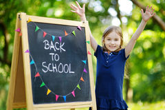 Extremely excited little schoolgirl. Adorable little schoolgirl feeling very excited about going back to school Royalty Free Stock Photos