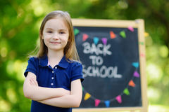 Extremely excited little schoolgirl. Adorable little schoolgirl feeling very excited about going back to school Stock Image