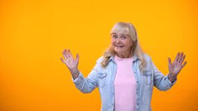 Extremely excited old lady posing on camera, happy with life after retirement stock photo