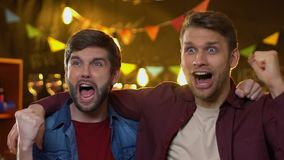 Extremely glad sports fans celebrating national team goal and gesturing in bar. Stock footage stock video footage