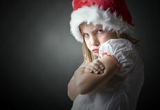 Extremely grumpy christmas child Royalty Free Stock Images