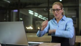 Extremely happy businesswoman dancing in workplace, celebrating successful news. Stock footage stock video