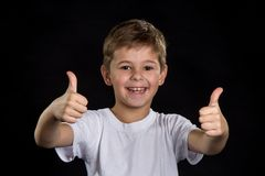 Extremely happy, cheerful and smiling boy with thumbs up stock images
