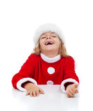 Extremely happy little girl with missing teeth. Laughing in christmas outfit Stock Image