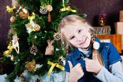 Extremely happy little girl with thumbs up Royalty Free Stock Image