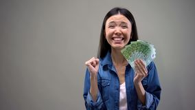 Extremely happy woman holding euros banknotes, good salary, employment concept. Stock photo stock photos