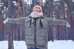 Extremely happy woman rejoices nice wintry weather in the forest Stock Photo