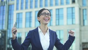 Extremely happy woman in suit reading good news, office worker getting promotion stock video footage