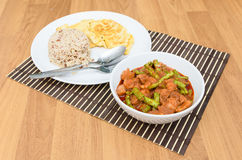 Extremely hot stir fried string bean with pork have rice and ome Royalty Free Stock Images