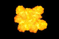 Extremely massive fire explosion, orange color with sparks. Isolated on black background Royalty Free Stock Photography