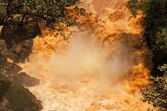 Muddy Water Fall. An extremely muddy waterfall found at the border between Tanzania and Rwanda royalty free stock photo