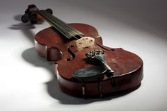 Extremely old scratched violin Stock Photo