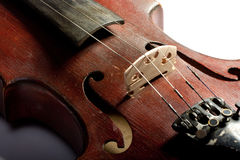 Extremely old scratched violin Stock Images
