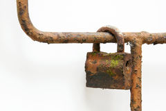 Extremely Rusted Padlock on Bar of Rusty Metal Gate Stock Images