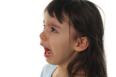 Extremely sad little girl crying Royalty Free Stock Photos