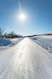 Extremely slippery winter road on a sunny day Stock Photos