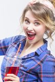 Extremely Surprised Caucasian Blond Woman in Checked Shirt Drinking Red Juice Using Straw Royalty Free Stock Photo