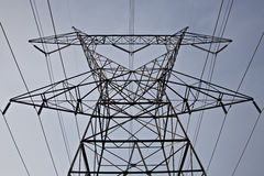 Extremely tall electrical tower and power lines Stock Images