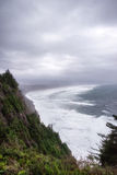 Extremely windy and cloudy day along Oregon coast cliff Stock Photo