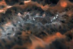Extremes Makro des dunklen Achatscheibenminerals mögen Lavaflüsse Stockbild
