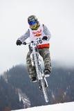 Extremes Schneegebirgsradfahren Stockbilder