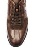 Extremidad de los zapatos masculinos aislados en blanco Foto de archivo