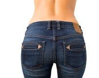 A extremidade da mulher nas calças de brim Imagens de Stock Royalty Free