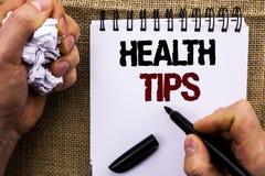 Extremidades de la salud del texto de la escritura de la palabra El concepto del negocio para las sugerencias sanas sugiere la id Foto de archivo