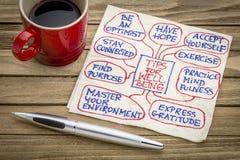 Extremidades para el bienestar en servilleta Foto de archivo libre de regalías