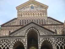 Extremity and facade of the romanesque cathedral of Amalfi nel south of Italy. stock photos