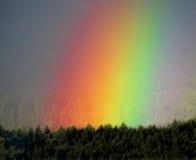 Extremo de un arco iris Imagenes de archivo