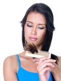 Extremos partidos del pelo de la mujer Fotos de archivo