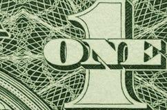 Extremt slut upp av ETT och 1 från en amerikansk dollarräkning royaltyfria foton