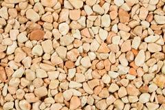 Extremt slut upp naturlig stenmatta, beiga och kr?m som f?rgas i olika skuggor och toner av beiga Bel?ggning f?r dekorativ sten arkivfoton