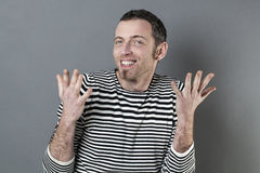 Extrovert 40s man expressing himself with hands Stock Photography