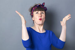 Extrovert 30s woman with fifties hairstyle enjoying competition Royalty Free Stock Image