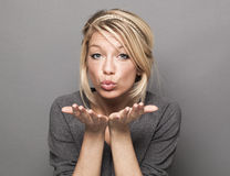 Extrovert 20s woman showing tenderness in pouting and kissing signs Royalty Free Stock Photos