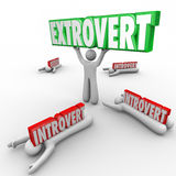 Extrovert Vs Introvert People Uninhibited Outgoing Character. Extrovert vs Introverted people with outgoing character holding a word in triumph and shy people Royalty Free Stock Photography
