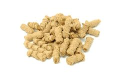 Extruded Bran. A pile of extruded bran on a white background Stock Photography