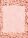 Extruded frame in a foundation cosmetic powder royalty free stock photography