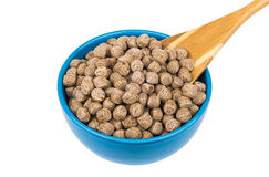 Extruded rye bran in blue bowl and bamboo spoon Stock Images