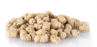 Extruded wheat bran pellets isolated on white. Extruded wheat bran pellets isolated on white Royalty Free Stock Photos