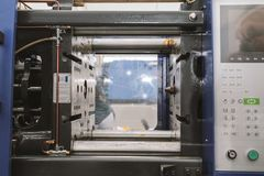 Extrusion manufacturing line - extruder, close up. View Stock Photo